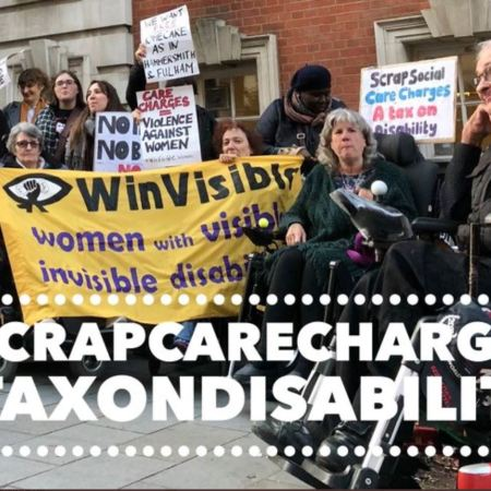 A mixed picket of disabled women and men. Some of the women are holding WinVisible's banner. A placard says: Scrap Social Care charges -- a tax on disability.